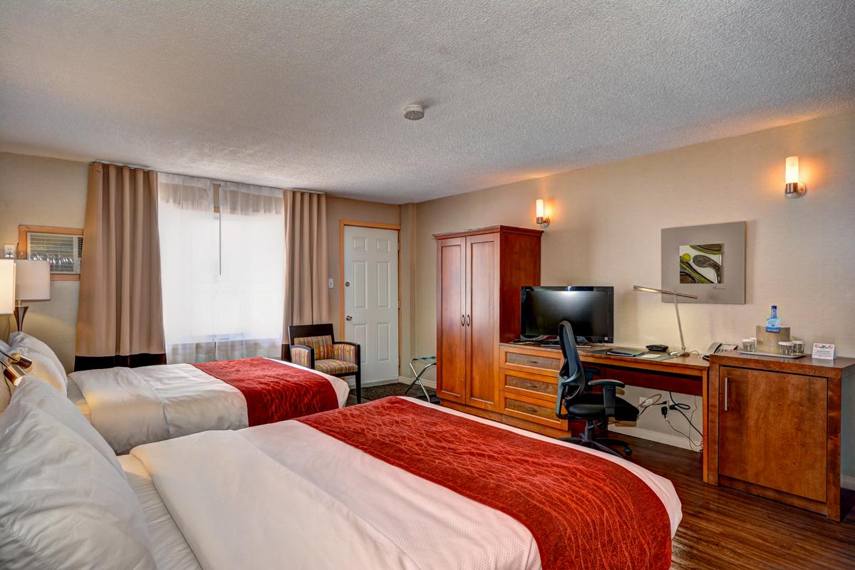 Chambre traditionnelle avec patio 2 grands lits